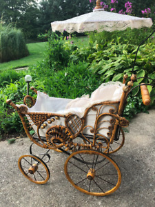 Antique Doll carriage made from wicker - very old and charming.