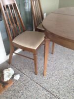 Table that sits from4 to 12 ( with the leaves ) ,buffet &2chair