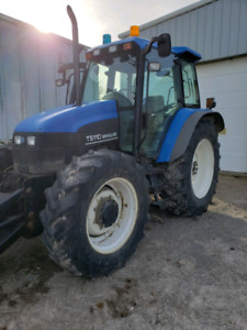New Holland Tractor  and Snow plow