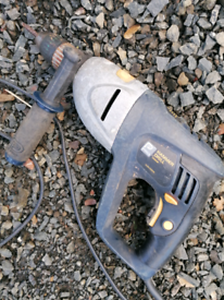 Hammer drill. Working. Electric