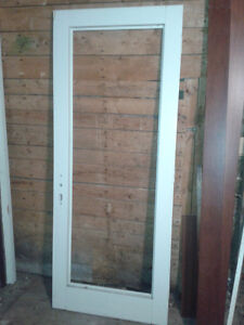 Exterior screen door & a used garden door.  $50