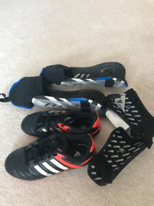 Soccer shoes size 1.  Shin and ankle pads