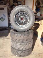 "14"" Yokohama ice guard winter tires on 5 bolt 100mm rims"