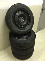 Four 215/60R16 Michelin X-Ice Xi3 Winter Tires with Steel Rims