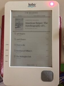Kobo e-reader with 50+ books *price reduced