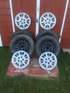 """$120.00 OBO 4-16"""" Rims and Hubcaps. 5 bolt pattern."""