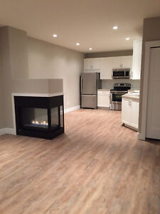 Brand new legal basement suite just off Broadway