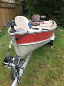 12 ft lauminum boat on trail with 15HP Mercury motor