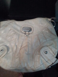 Authentic Guess Hand bag in a slightly off white color.
