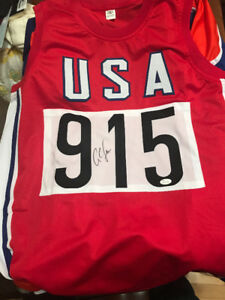 Carl Lewis Autographed Team USA Olympic Track Jersey with COA