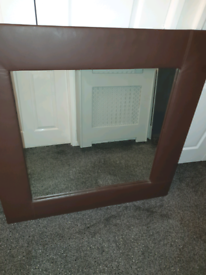 """New 48"""" × 48"""" Brown Leather Framed Mirror."""