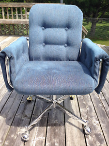Two Matching Swivel base Arm Chairs