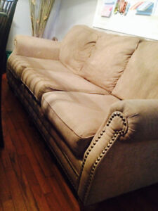Beige couch and love seat set