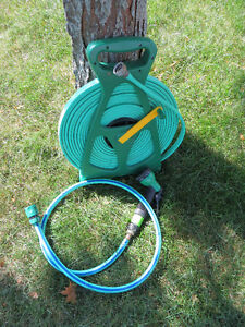 Nearly-new 50' flat hose on reel