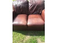 Brown leather two seater sofa for sale