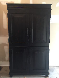Beautiful solid wood black TV stand from Pier One Imports.
