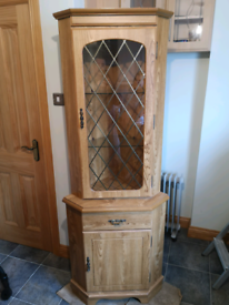 Two cupboard corner display units with drawers