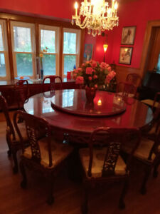 Round dinning table and 12 chairs with hutch