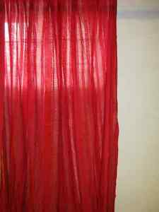 One pair of window curtains (red in colour).