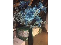 Teal green flower arrangement and vase