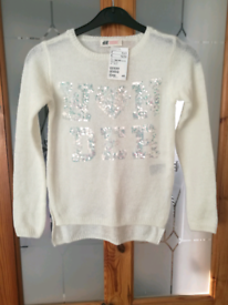 Girls cream jumper size 8-10 years