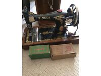 Antique SINGER sewing machine with key and box