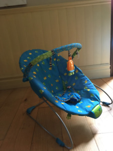 Vibrating bouncy baby chair