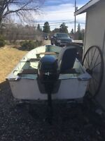 Boat, trailer and mint motor, with tank and hose
