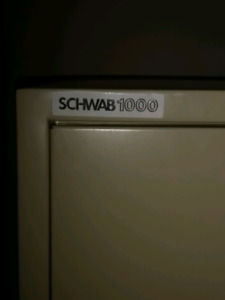 Schwab 1000 - 2 matching 4 drawer fire proof filing cabinets.