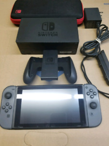 Nintendo switch with a bunch of games on the system
