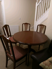 Mahogany Extendable dining table and 4 chairs.