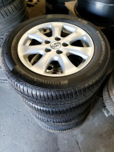 Brand new 215 60 16 Continental tires on OEM Toyota Camry rims