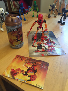 29 Bionicles with instructions, extra parts, posters, and comics