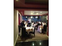 Restaurant & Takeaway lease for sale with flats above.