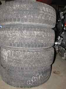 Set of 4 - 225 65r 17 Studless winter tires with steel rims/caps Prince George British Columbia image 3