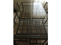 Table and 4 chairs with sofa bed