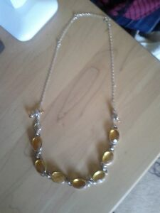 Silver Necklace. Lots of Amber. Picture.