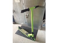 Green stunt scooter