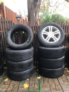 Set of 4 - 255/55R18  rims with winter and summer tires.