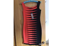 D. Exterior orange & black fitted dress size M Still with tags