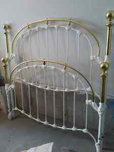 Quality brass and rod iron head board. Foot board and bed frame
