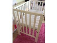 Mamas and Papas petite cot in white and white changing table with cupboard