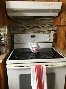 Stove,Smooth top and fan,18 cubic ft. Fridge and dishwasher.