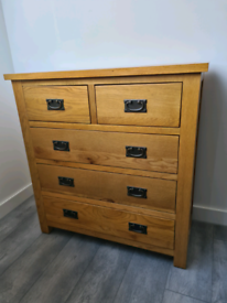 Solid wood chest of drawers.