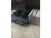 PS3 Slim + controllers and games