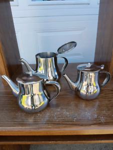 Set of 3 stainless steel teapots.