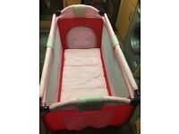 Red and pink travel cot brand new never been used