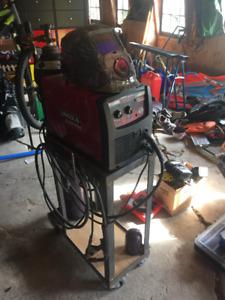 Mig pak 140 welder with bottle and auto darkening helmet