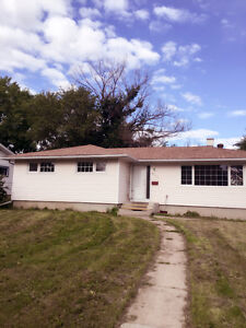 West end four bedroom house main floor  - utilities included