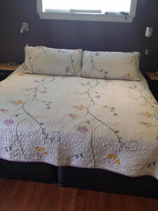 Quilted King size comforter, and pillow shams.